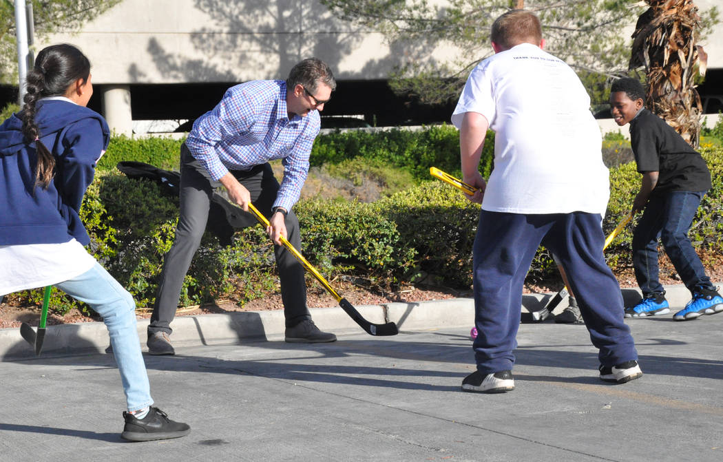 Murray Craven, senior vice president of the Vegas Golden Knights and former National Hockey League center, plays street hockey with children from After-School All-Stars Mar. 7 at AutoNation Toyota ...