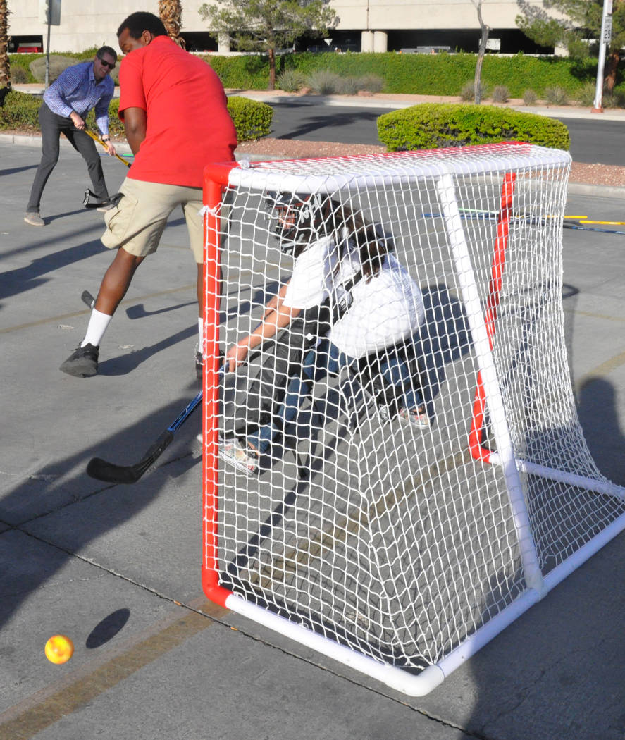 Vegas Golden Knights and AutoNation Toyota hosted a street hockey clinic with children from After-School All-Stars Mar. 7 in the dealersip parking lot. Photo by Buford Davis, Las Vegas Business Press