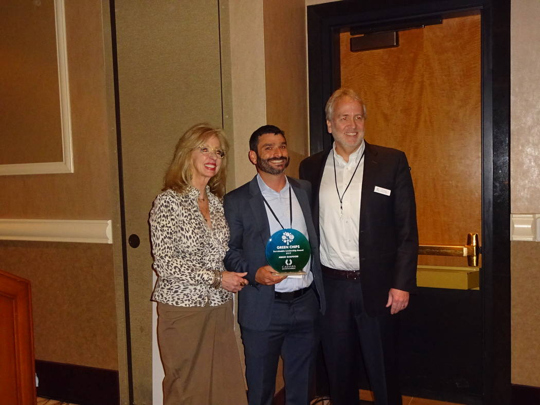 Craig Ruark/Las Vegas Business Press Jan Jones Blackhurst and Tom Perrigo present the Sustainable Leader Award to Arash Ghafoori, executive director, Nevada Partnership for Homeless Youth.