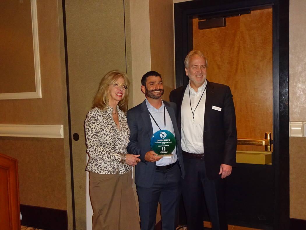 Craig Ruark/Las Vegas Business Press Jan Jones Blackhurst and Tom Perrigo present the Sustainable Leader Award to Arash Ghafoori, executive director, Nevada Partnership for Homeless Youth.