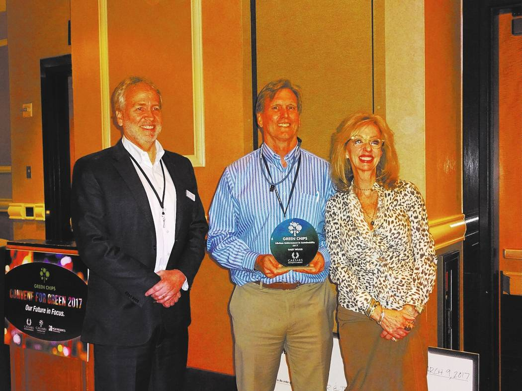 Craig Ruark/Las Vegas Business Press Jan Jones Blackhurst and Tom Perrigo present the Lifetime Achievement in Sustainability Award to Gary Wood, Green Chips co-founder and Renewable Energy Program ...