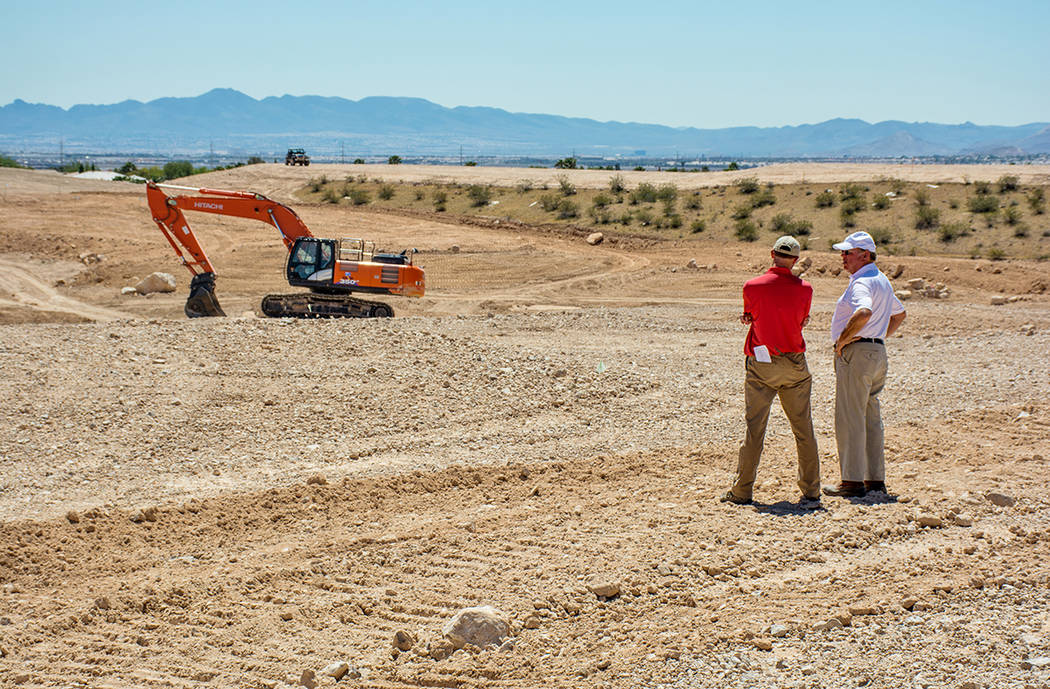 Courtesy  Golf designer Tom Fazio, right, looks at the place where his championship golf course was created as the showpiece for The Summit, an ultra-luxury residential community in Summerlin. The ...