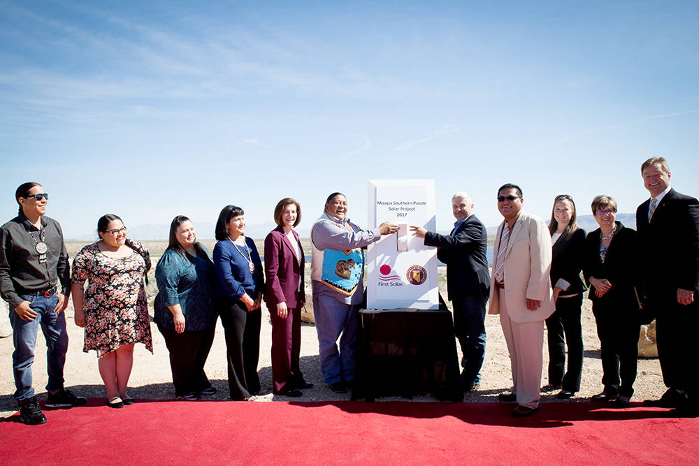 Tribal member Greg Anderson from the Moapa Band of Paiutes throws the big switch to turn on the Moapa Southern Paiute Solar installation with the help of Georges Antoun, chief commercial officer a ...