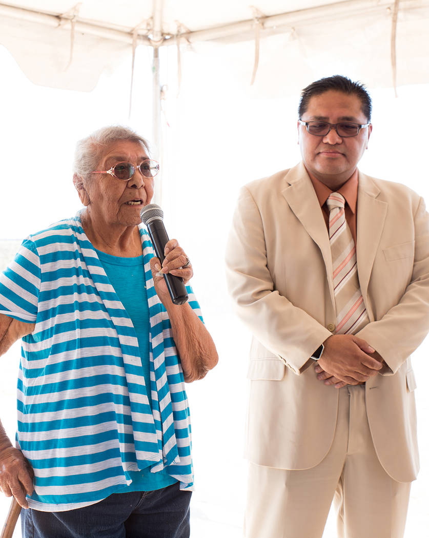 Juanita Kinlichinie, an elder of the Moapa Band of Paiutes, says a prayer in her native language to bless the Moapa Southern Paiute Solar facility while Darren Doboda, chairman of the tribal counc ...