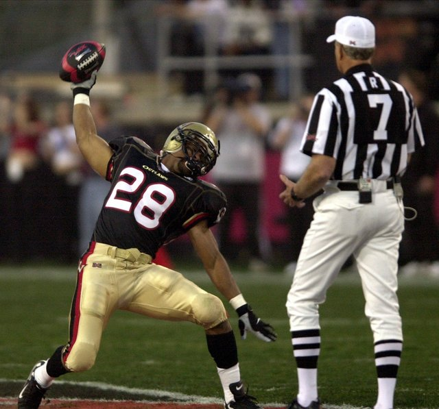 Las Vegas Outlaws safety Jamel Williams celebrates his victory in the scramble for the ball over the New York/New Jersey Hitmen at Sam Boyd Stadium in Las Vegas on Saturday, Feb. 3, 2001. The scra ...