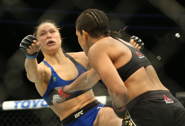 Amanda Nunes lands a strike against Ronda Rousey during their bantamweight championship fight at UFC 207 at T-Mobile Arena on Friday, Dec. 30, 2016, in Las Vegas. Benjamin Hager/Las Vegas Review-J ...