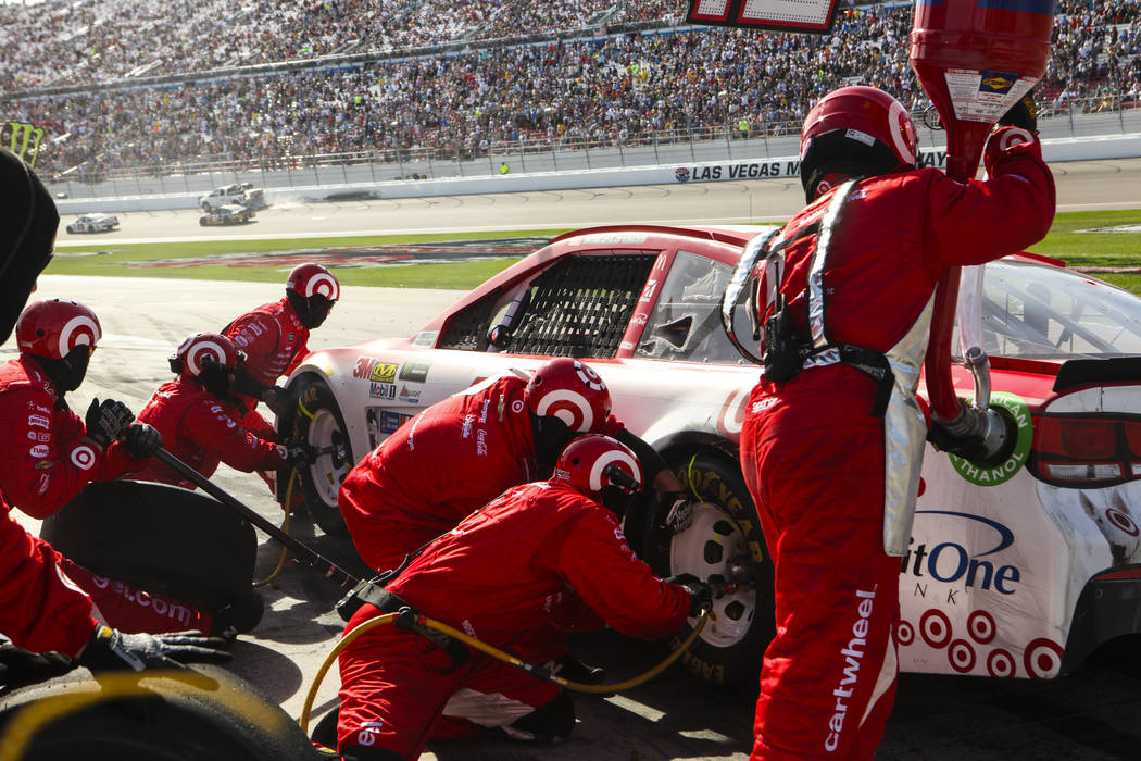 Miranda Alam/Las Vegas Business Press The pit crew for Kyle Larson (42) change the tires on his car during the Monster Energy NASCAR Cup Series Kobalt 400 auto race at Las Vegas Motor Speedway Mar ...