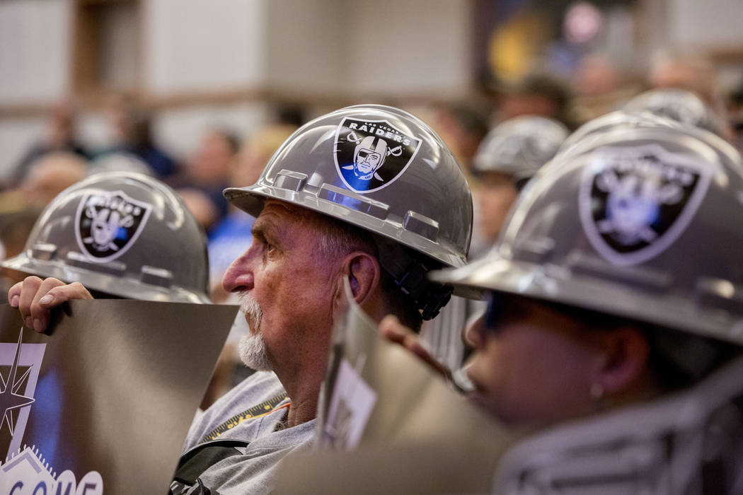 Union Worker Martin Wozny dresses in Las Vegas Raider attire during a Las Vegas Stadium Authority meeting on the status of lease agreement negotiations with the Oakland Raiders at the Clark County ...