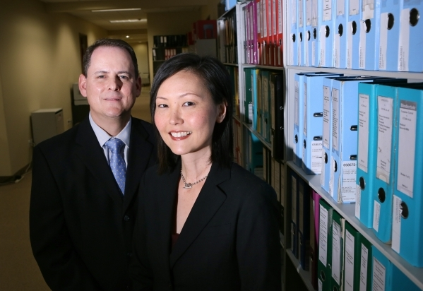 Attorneys Michael Feder, left, and Jennifer Ko Craft stand for a photograph near case files at Dickinson Wright PLLC Tuesday, Sept. 29, 2015, in Las Vegas. Feder and Ko Kraft work in media, sports ...