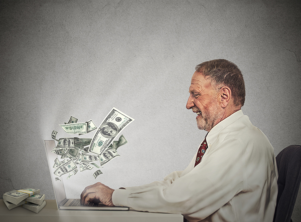 Man getting money from a computer. THINKSTOCK