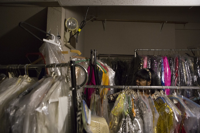 Manager Glenda Scott makes her way through the second floor of Williams Costume, where thousands of costumes are stored, looking for a light switch on Thursday, Feb. 16, 2017, in Las Vegas. (Bridg ...