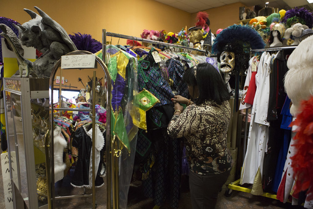 Manager Glenda Scott looks through items at Williams Costume on Thursday, Feb. 16, 2017, in Las Vegas. Scott has worked at Williams Costume for 20 years. (Bridget Bennett/Las Vegas Business Press)
