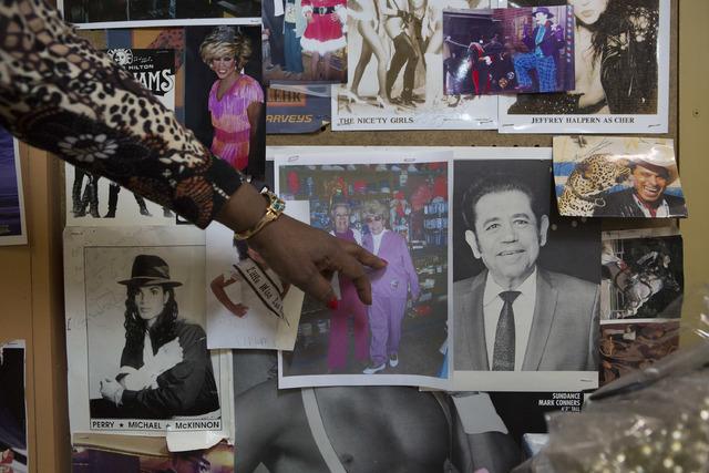 Manager Glenda Scott points to a photo of Nancy Baker, the owner of the store that has passed away, at Williams Costume on Thursday, Feb. 16, 2017, in Las Vegas. (Bridget Bennett/Las Vegas Busines ...