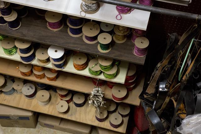 Spools of sequins are stored on shelves at Williams Costume on Thursday, Feb. 16, 2017, in Las Vegas. (Bridget Bennett/Las Vegas Business Press)