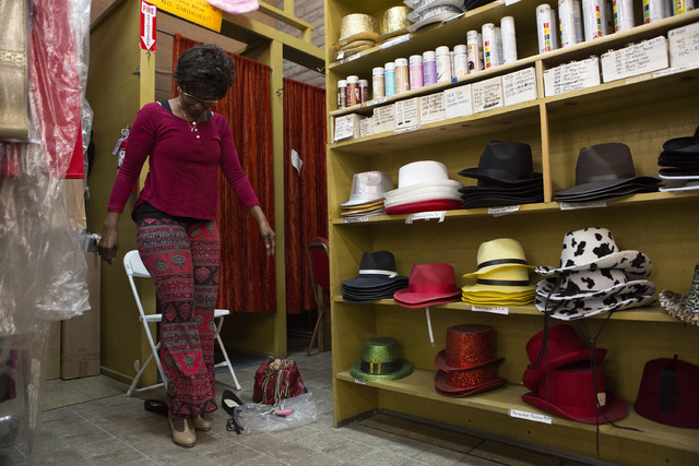 Customer Tinia Bradshaw tries on a pair of tap shoes at Williams Costume on Thursday, Feb. 16, 2017, in Las Vegas. (Bridget Bennett/Las Vegas Business Press)