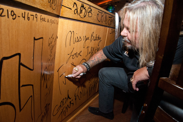 Vince Neal, rock musician with Motley Crue and owner of the Las Vegas Outlaws arena football team, leaves a final message at the Hard Rock Hotel's Center Bar during its final hours June 28. (Court ...
