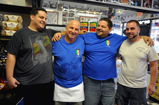 At Cugino's Italian Deli & Pizza Restaurant, Freddie Pica, the father, is surrounded by his sons. Left to right are son Mike; Dad; son Don and son Nando. (Photo by Joe Coomer, special to the Las ...