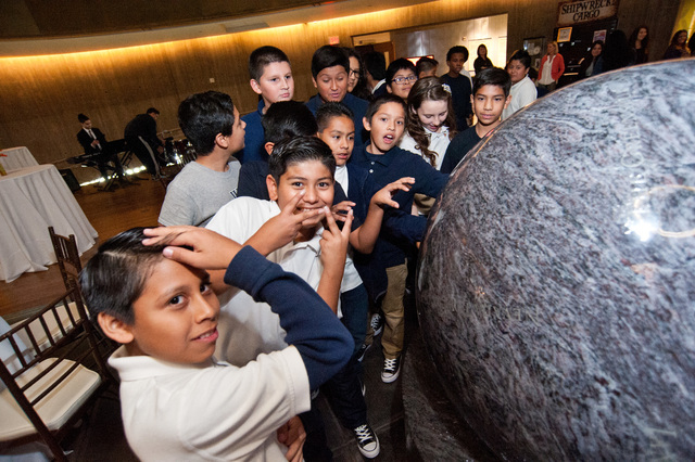 During a celebration of the rebranding of Core Academy, Powered by the Rogers Foundation, last November, students are intrigued by a big blue marble earth science exhibit at Springs Preserve. (Cou ...