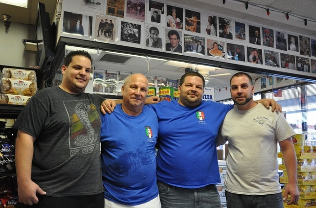 Cugino's Italian Deli & Pizza Restaurant is a family business. Freddie Pica, the father, is surrounded by his sons. Left to right are son Mike; Dad; son Don and son Nando. (Photo by Joe Coomer,  ...