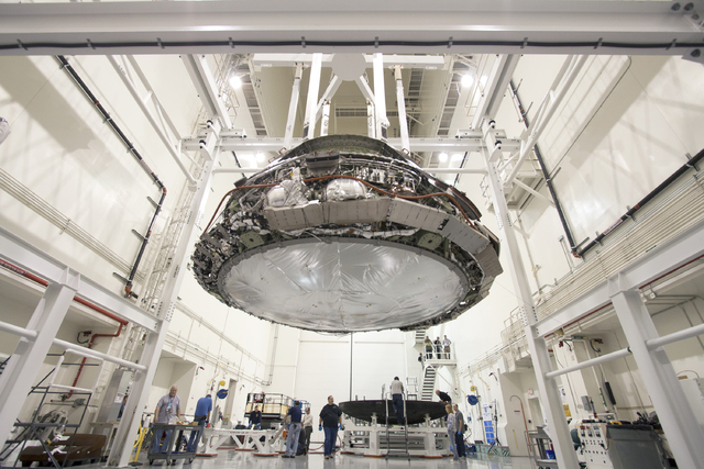 Engineers take a closer look at NASA's Orion spacecraft and its data upon successfully returning to earth from its flight test in December, 2014. (Courtesy NASA)