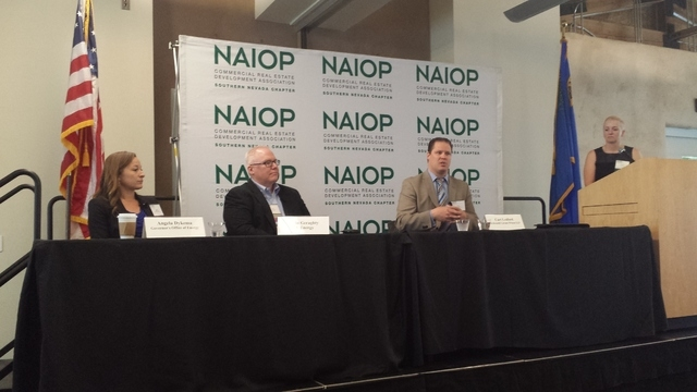 Jennifer Turchinj of Coda moderates a discussion of utility-scale renewable energy at a recent NAIOP meeting. Photo by Dana Berggren, NAIOP commercial real estate broker.