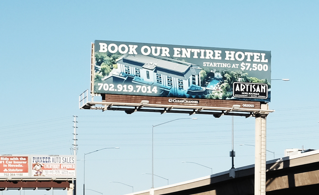 A billboard adjacent to the eastbound Desert Inn overpass, facing westbound traffic, advertises the availability of the Artisan hotel for rent. Ulf Buchholz/Business Press