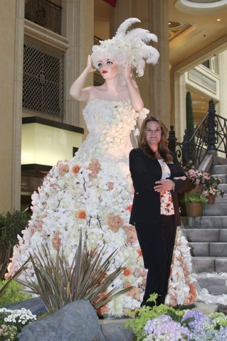 Dana Beatty stands by her latest creation, a Venetian carnival-themed display at The Venetian/the Palazzo. Photo of Stephanie Annis