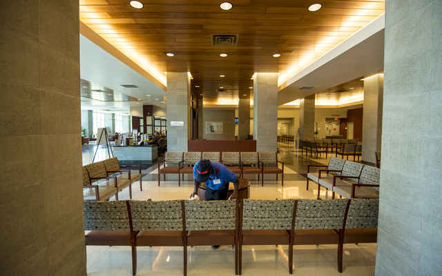 Alex Johnson wipes down chairs at Centennial Hills Hospital Medical Center in Las Vegas on Wednesday, June 3, 2015. Alex is part of a development program with Opportunity Village to help people wi ...