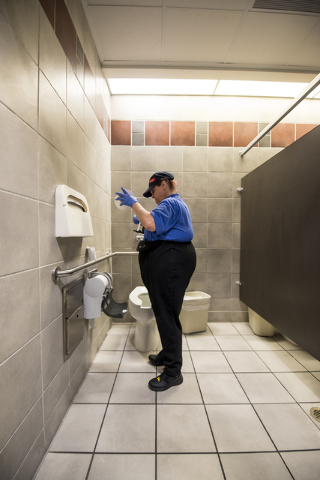 Paula Eisley changes toilet paper at Centennial Hills Hospital Medical Center in Las Vegas on Wednesday, June 3, 2015. Paula is part of a development program with Opportunity Village to help peopl ...
