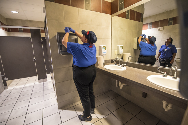 Paula Eisley changes paper towels while Tia Campbell looks on at Centennial Hills Hospital Medical Center in Las Vegas on Wednesday, June 3, 2015. Paula is part of a development program with Oppor ...