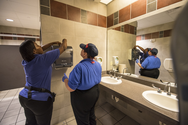 Tia Campbell assists Paula Eisley with changing paper towels at Centennial Hills Hospital Medical Center in Las Vegas on Wednesday, June 3, 2015. Paula is part of a development program with Opport ...