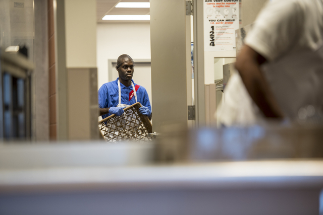 LaRon Thomas (accent over R) washes dishes at Centennial Hills Hospital Medical Center in Las Vegas on Wednesday, June 3, 2015. LaRon is part of a development program with Opportunity Village to h ...