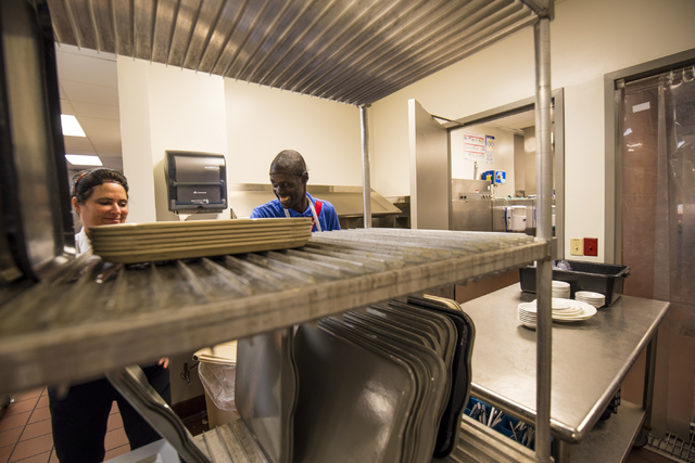 LaRon Thomas (accent over R), right, laughs with a kitchen worker at Centennial Hills Hospital Medical Center in Las Vegas on Wednesday, June 3, 2015. LaRon is part of a development program with O ...