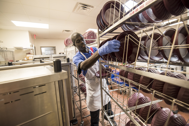 LaRon Thomas (accent over R) places bowls to dry at Centennial Hills Hospital Medical Center in Las Vegas on Wednesday, June 3, 2015. LaRon is part of a development program with Opportunity Villag ...