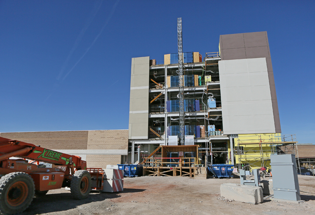 Construction work is giving shape to the Henderson Hospital being built at the 170-acre Union Village development east of U.S. 95 and Galleria Drive. Completion of Henderson Hospital is expected t ...