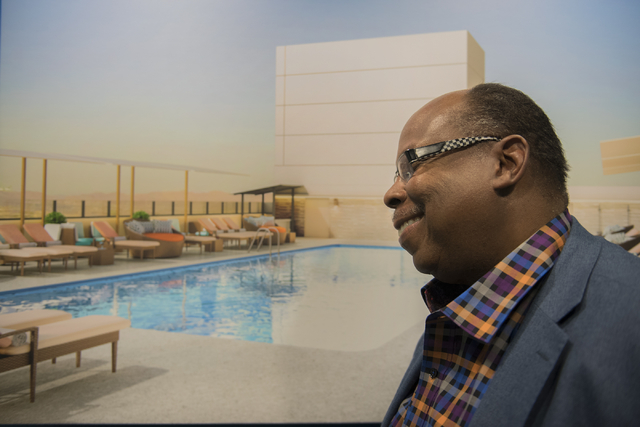 Interior designer Brian Thornton poses for a photo in front of a 3D rendering he created of the Radius Pool inside the Stratosphere hotel-casino in Las Vegas on Friday, May 29, 2015. (Martin S. Fu ...