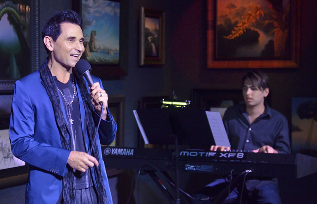 """Jersey Boys"" star Travis Cloer, left, performs with Chris Lash on keyboards during a promotional event and charity auction at Kush Fine Art in the Forum Shops at the Caesars Palace hote ..."
