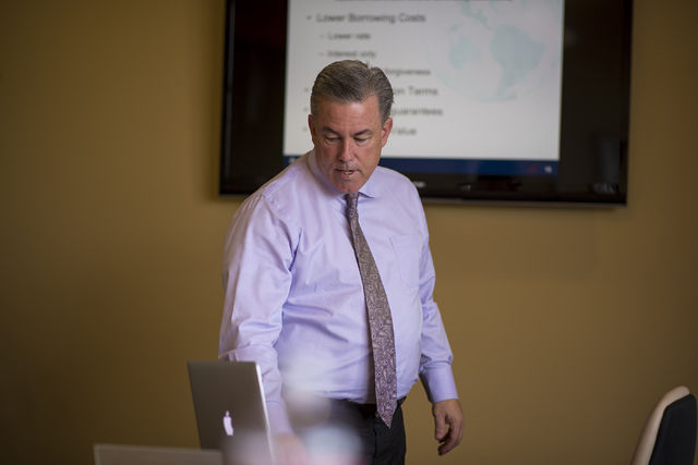 Mike Ballard of Ballard Consulting reviews a presentation in a conference room at his office in Henderson on Thursday, May 14, 2015. (Joshua Dahl/Las Vegas Review-Journal)