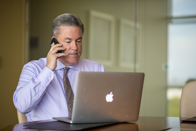Mike Ballard of Ballard Consulting takes a phone call in a conference room at his office in Henderson on Thursday, May 14, 2015. (Joshua Dahl/Las Vegas Review-Journal)