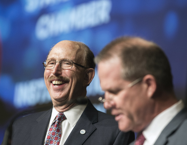 Bill Noonan, incoming chairman of the Las Vegas Metro Chamber of Commerce, laughs while Nevada Lt. Gov Mark Hutchison speaks during an instillation luncheon at Cosmopolitan on Thursday Dec. 8, 201 ...
