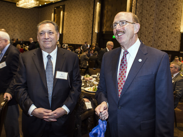 Keith Smith, left, president and CEO of Boyd Gaming, and  Bill Noonan, incoming chairman of the Las Vegas Metro Chamber of Commerce, stand during an instillation luncheon at Cosmopolitan on Thursd ...