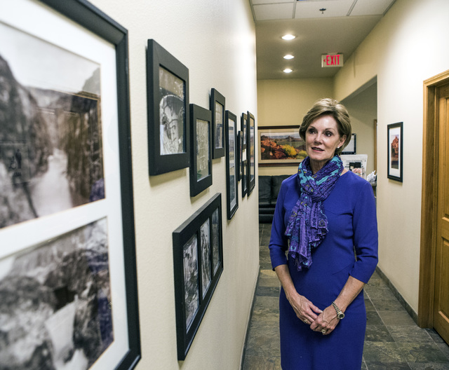 Carol Cline-Ong, founder and principal of MDL Group, views historic photos of Hoover Dam in the company's hallway on Monday, Nov. 28, 2016. Jeff Scheid/Las Vegas Review-Journal Follow @jlscheid