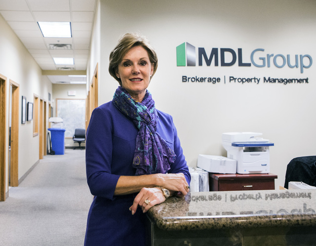 Carol Cline-Ong, founder and principal of MDL Group, stands in the company's lobby on Monday, Nov. 28, 2016. Jeff Scheid/Las Vegas Review-Journal Follow @jlscheid