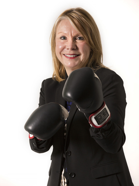 Pam Heiney poses with kickboxing gloves in the Las Vegas Review-Journal studio on Nov. 23, 2016 in Las Vegas. David Guzman/Las Vegas Review Journal Follow @DavidGuzman1985