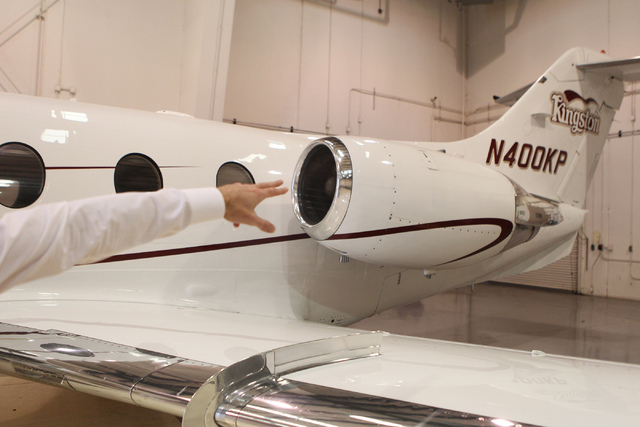 Greg Woods, CEO for Cirrus Aviation Services, talks about the Hawker 400, a small twin-engine jet, part of their jet fleet during an interview at the Atlantic Aviation terminal at McCarran Interna ...
