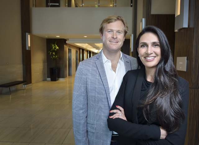 Chris Dornin, co-founder and CEO of Dornin Investment Group, and his wife Marcella, co-founder and chief operating officer, are shown in the lobby of one of the properties they own at 6750 Via Aus ...