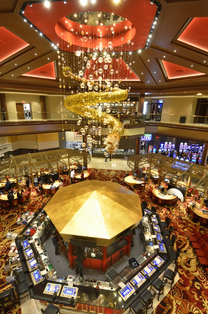 The interior of the Lucky Dragon hotel-casino at 300 W. Sahara Ave. in Las Vegas is shown as workers put finishing touches on the interior and family and friends of employees play the games on Thu ...
