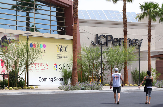 People walk near a building wrap announcing new businesses to come at Galleria at Sunset mall Thursday, June 4, 2015, in Henderson. Galleria at Sunset, which has expanded to just over 1 million sq ...