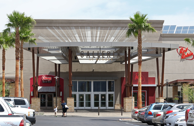 People approach an entrance to Galleria at Sunset mall Thursday, June 4, 2015, in Henderson. Galleria at Sunset, which has expanded to just over 1 million square feet since it opened in 1996, has  ...