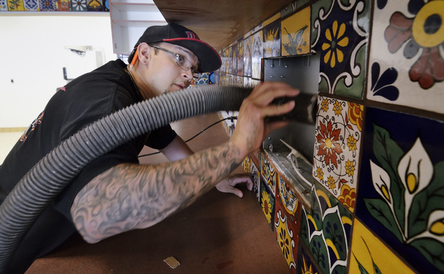 Tile setter Andrew Hughbanks cleans up a work area at a Dotty's property under renovation on the site of the former Terrible's Town Casino and Bowl at 642 S. Boulder Highway in Henderson on Tuesda ...